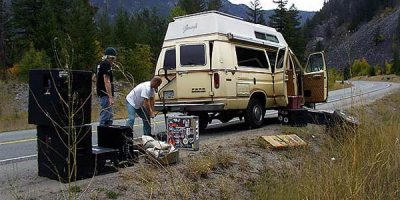 VANCOUVER, BC- MAY 15-2008 - Bill Johnston changes a tire on his band's touring van near Princeton, British Columbia in 2006. The van was used by Terry Fox during his Marathon of Hope. Photo by Ernie Hawkins